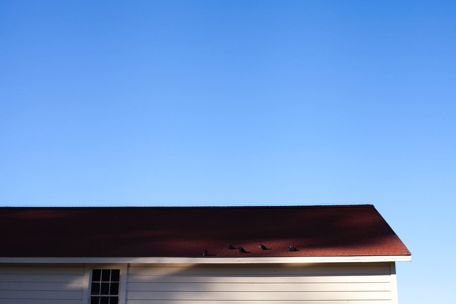can you install a metal roof over shingles?